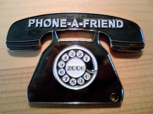 charm of telephone with phone a friend written on it