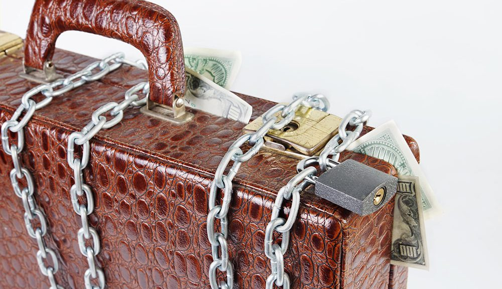 briefcase with chains and money