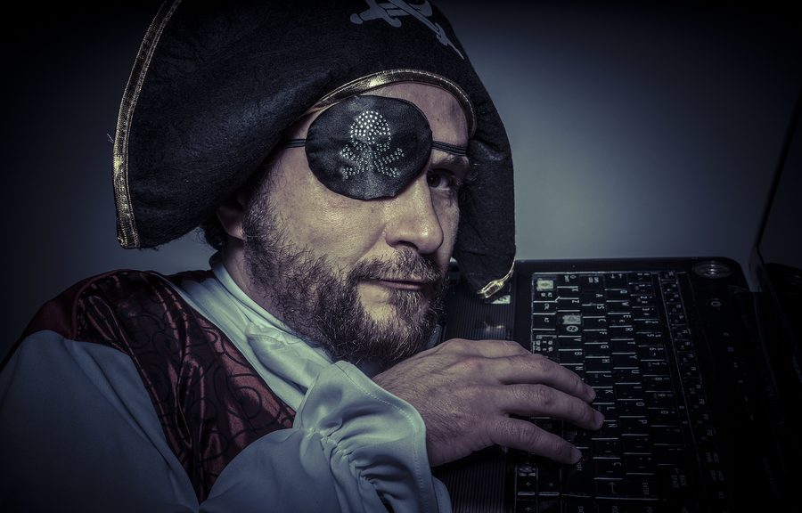 Pirate trying to infect your computer with malware