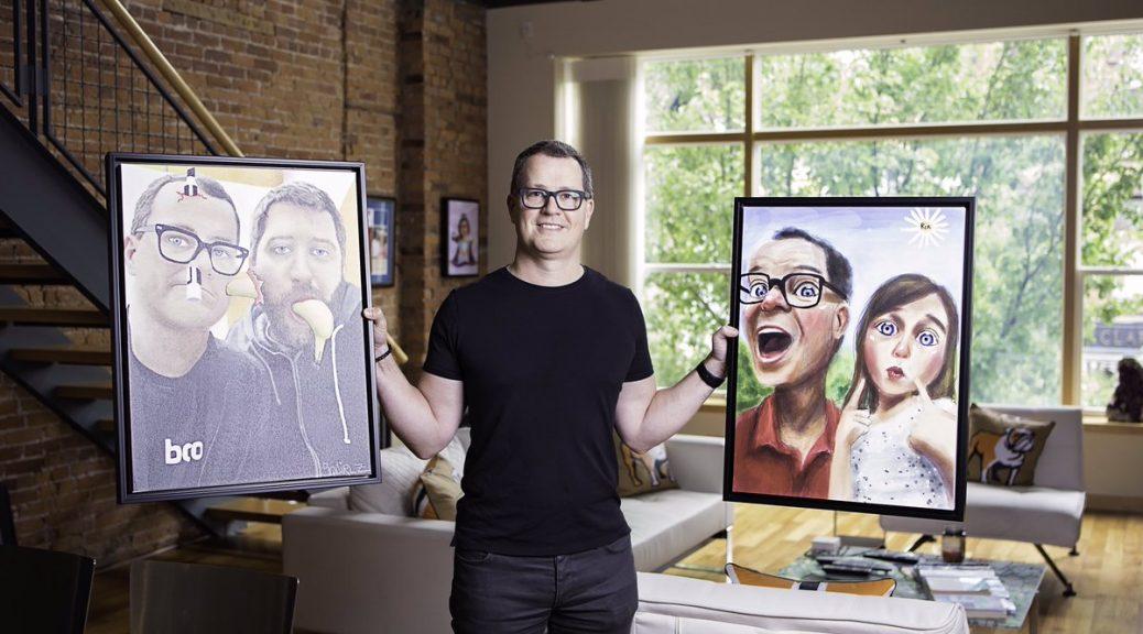 kris jones holding paintings of himself