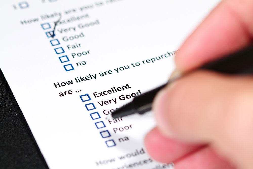 person filling out a survey