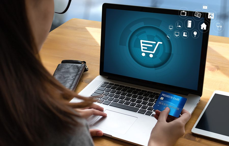 woman at computer using an e-commerce website