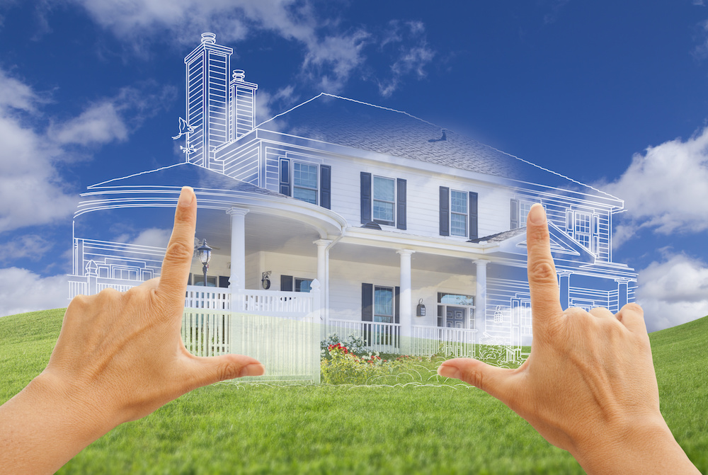 Hands Framing Beautiful House Drawing and House Above Grass