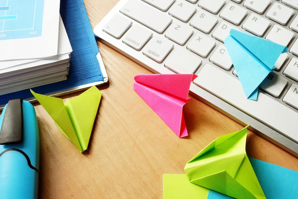 paper planes on a desk