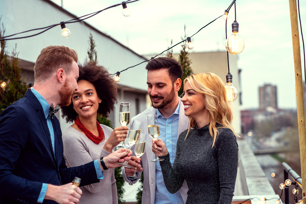 four people toasting at holiday party