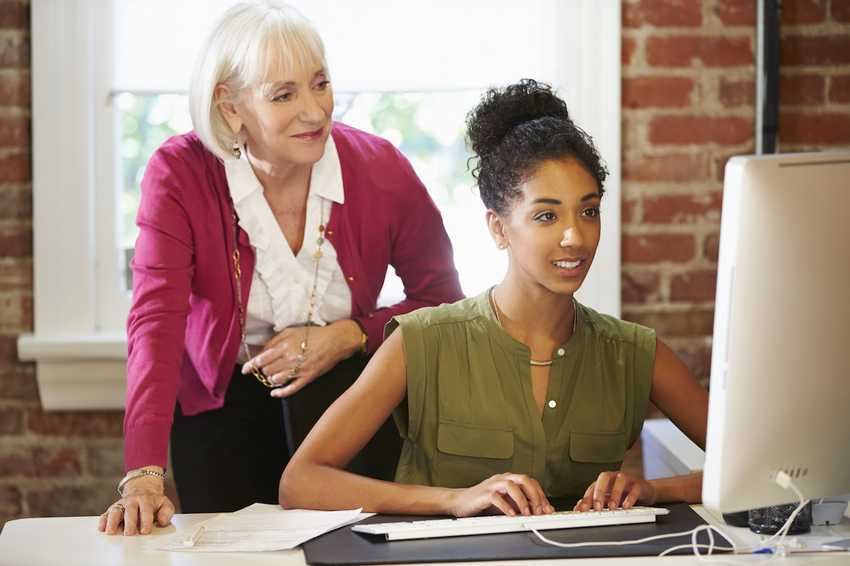 older woman mentoring younger woman