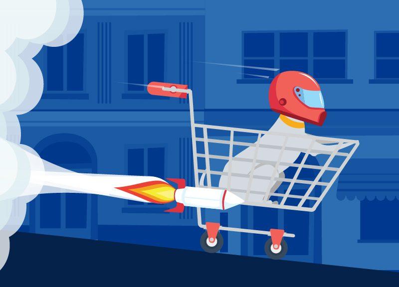 dog riding in rocket powered shopping cart